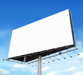 Billboard with empty screen against blue sky Stock Images