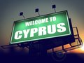 Billboard welcome to cyprus at sunrise green on the rising sun background Royalty Free Stock Images
