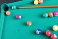 Billiard balls and cue Stock Images