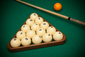 Billiard balls and cue on a table Royalty Free Stock Image