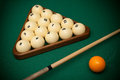 Billiard balls and cue on a table Royalty Free Stock Photography