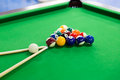 Billiard balls on green table Royalty Free Stock Images