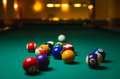 Billiard balls on green table. Royalty Free Stock Photo