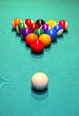 Billiard balls in the position of the pyramid on green baize table Royalty Free Stock Photography
