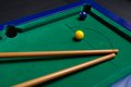 Billiard cue lying on green table Stock Photography