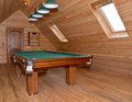 The billiard hall on a mansard floor of the guest house Royalty Free Stock Photo