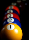 Billiard lines lined up balls against a black background Royalty Free Stock Images