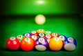 Billiard spheres fifteen lay on green cloth Royalty Free Stock Images