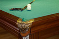 Billiard table hole balls cue and glove on green cloth Royalty Free Stock Image