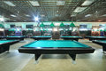 Billiard tables inside club with green cloth with green metal lamp Royalty Free Stock Images