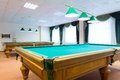 Billiard tables two in a room with windows Royalty Free Stock Image