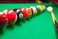 Billiards close up of billiard balls and cues on green table Royalty Free Stock Photo