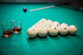 Billiards cognac balls in wooden triangle and cue Stock Photo