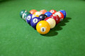 Billiards of pool a set or balls on a green flet table with copy space Royalty Free Stock Image