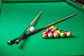 Billiards top view of billiard balls and cues on green table Stock Image