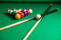 Billiards top view of billiard balls and cues on green table Royalty Free Stock Images
