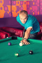 Billiards young people playing in the club Royalty Free Stock Photos
