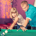 Billiards young people playing in the club Stock Photography