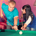 Billiards young people playing in the club Royalty Free Stock Photography