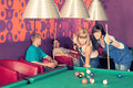 Billiards young people playing in the club Stock Image