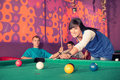 Billiards young people playing in the club Stock Photo