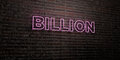 BILLION -Realistic Neon Sign on Brick Wall background - 3D rendered royalty free stock image