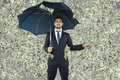 Billionaire businessman hold umbrella in the rain of money Stock Photography