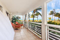 Billowing white curtains on a sunny screen in porch with an oceanfront view Stock Photo