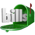 Bills word in mailbox paying down debt credit card payment the a green metal to illustrate your such as and utilities payments Royalty Free Stock Photo