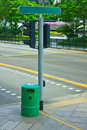 Bin on intersection green locate with empty green board Stock Image