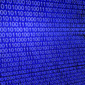 Binary code on blue background Royalty Free Stock Photos