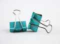 Binder clip blue paper isolated on white Royalty Free Stock Images