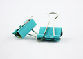 Binder clip blue paper isolated on white Stock Images