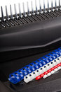 Binding machine with colour springs Stock Photos
