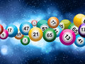 Bingo ball burst on a glowing blue background Royalty Free Stock Images