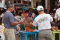 Bingo caller outside with crowd in background san clemente manabi ecuador circa august villagers and tourist playing san clemente Stock Photos