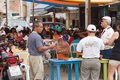 Bingo caller outside with crowd in background san clemente manabi ecuador circa august villagers and tourist playing san clemente Royalty Free Stock Photography