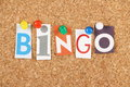 Bingo the word in cut out magazine letters pinned to a cork notice board is a gambling game and the word is used to announce Stock Photo