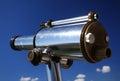 Binocular metal public at blue sky Stock Images