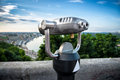 Binocular next to the waterside promenade i looking out city and river Royalty Free Stock Image