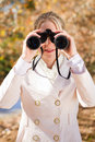 Binocular woman Stock Images