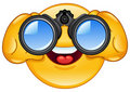 Binoculars emoticon Royalty Free Stock Photo