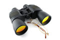 Binoculars and eyeglasses over white Stock Photo