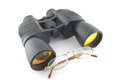 Binoculars and eyeglasses over white Royalty Free Stock Image