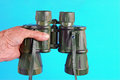 Binoculars in Hand Stock Photography