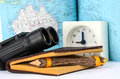 Binoculars and map book clock with a background Stock Photography