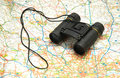 Binoculars over the map Stock Photo