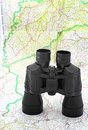 Binoculars over the map Stock Photos
