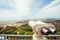 Binoculars for sightseeing from the highest point of the city Royalty Free Stock Photo