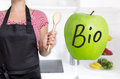 Bio Apple in german Organic concept is shown by chef Royalty Free Stock Photo